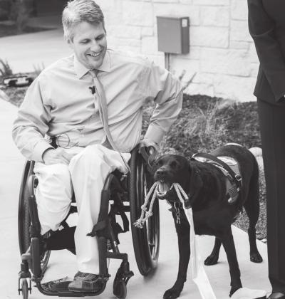 Baylor Scott & White Health, Texas' largest not-for-profit health system, has been recognized for disability inclusion. Retired U.S. Air Force Staff Sgt. Jason Morgan & service dog Rue assist with a ribbon cutting ceremony at Canine Companions for Independence at Baylor Scott & White Health – Kinkeade Campus Contributed