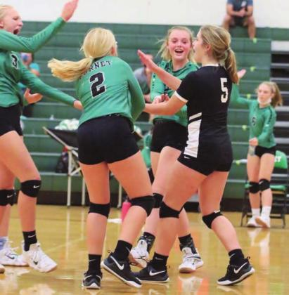 Freshman Lady Bulldogs celebrate a Kenna Davis (5) ace during Tuesday's district game in Burnet versus Taylor. The girls in green battled it out with the previously undefeated Taylor Lady Ducks claiming victory over their visitors in a back-and-forth three-set match. The freshman Lady Dawgs are currently 22-2 on the season after winning both of their matches last week. Wayne Craig/ Clear Memories