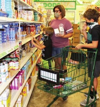 Parent Amber Koerner and her children, from left, Hayden, 13; Clayton, 7; and Makayla, 11 (not shown) did some shopping at the Marble Falls Dollar Tree, 500 U.S. 281, Aug. 3 and expect to take advantage of the state's sales tax holiday this weekend for discounts on school clothes. Connie Swinney/Burnet Bulletin