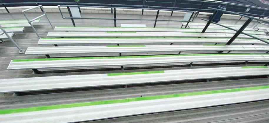 "Fans visiting Bulldog Field will notice green tape on certain rows of bleachers. This tape means that the row is unavailable for use due to ""social distancing"" regulations imposed on the district by the UIL. Contributed"