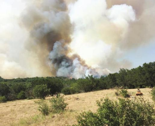 The Trails Fire, as it was named by the Texas A&M Forest Service, flared up near Blue Lake Drive on Thursday, Aug. 13. Multiple agencies responded to the blaze including Burnet County Sheriff's Office, Burnet County Pct. 4 Road and Bridge and Round Mountain VFD. Contributed/Mike Courtney
