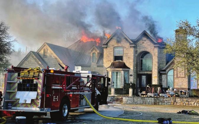 Firefighters from several agencies battled a blaze for several hours Jan. 4 off Park Road 4. The blaze, believed to have been started by a juvenile, destroyed the home and displaced the family. Contributed/James Oakley