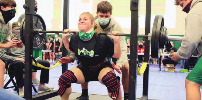 Lady Bulldog powerlifter Rylea Whitus pushes up a 285 pound squad in her final attempt at Thursday's meet hosted in Burnet. Whitus placed first in her class with a 755 pound total by way of this 285 pound squat, a 185 pound bench, and a 285 pound deadlift. The Burnet girls had a very successful meet claiming the overall team gold. Wayne Craig/Clear Memories