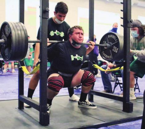 Burnet lifter Johnathan Baker digs deep during the squat competition at Thursday's powerlifting meet hosted by the Bulldogs. Baker took first place in his class with a 1,295 total. He completed lifts of 500 in the squat (pictured above), 315 in bench, and finished with a pull of 480 pounds. Wayne Craig/Clear Memories