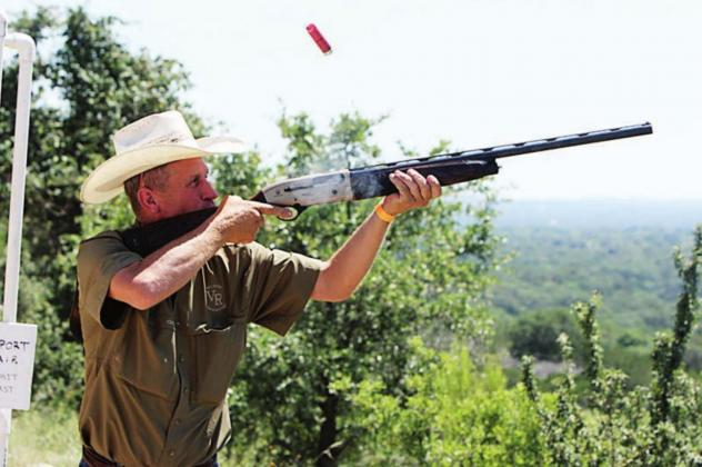 Todd Gibson sends a shell flying as he hits a target during the annual Shoot for Coop clay shooting fundraiser held Saturday, June 13, at the Despain Ranch. The event raises money for scholarships to college and Camp Peniel for area youth in memory of the late Cooper Despain. Photos by Kelly McDuffie Contributing Photographer