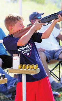 Braxton Dickens blasts the dickens out of a clay target during the youth competition at the Shoot for Coop annual clay shooting tournament and scholarship fundraiser on Saturday, June 13.