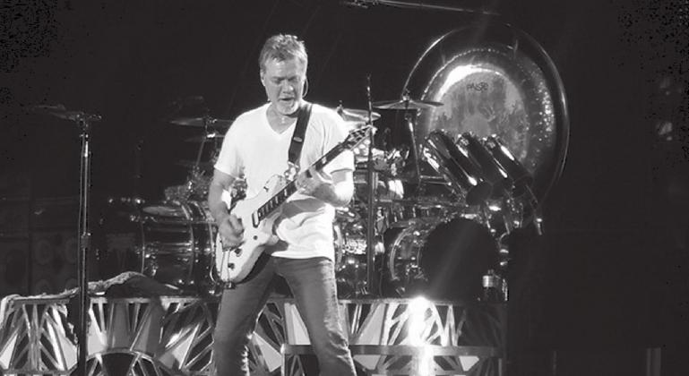 "Guitarist Eddie Van Halen, front, performs his classic instrumental ""Eruption"" during an August 2015 Van Halen concert in Dallas while brother Alex Van Halen plays drums in the background. The music world is mourning after Eddie died Tuesday, Oct. 6, at the age of 65. Lew K. Cohn/The Highlander"