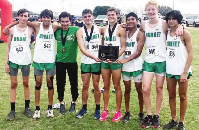 The Burnet boys cross country team proudly displays their first place plaque after earning a golden team finish in McGregor on Saturday. The Bulldogs combined effort scoring 44 points for the first place finish. Pictured, from left, are: Devin Petterson, Matthew Silva, Carlos Olivera, Andy Urista, Hudson Bennett, Moses DeLuna, Will Lewis and Diego Chavira. Contributed