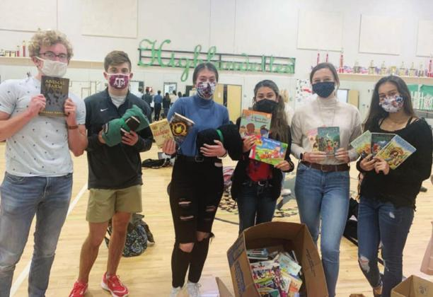 "Burnet High School students were tasked with creating a ""day of service"" project to benefit the Hill Country Children's Advocacy Center, in recognition of Martin Luther King Jr. day at the direction of their teacher, Emma Rothermund. Casey Burkhart, high school principal, encouraged the students to donate to the book and blanket drive during morning announcements. Contributed/Emma Rothermund"