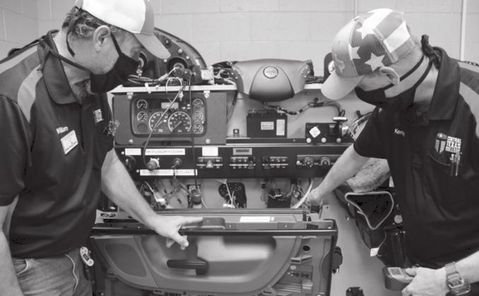 William Kirshner, Central Texas College diesel instructor, (left) works with student Kenneth Buster to troubleshoot a Freightliner diesel engine prototype in the CTC Career and Technology Education Center. Contributed